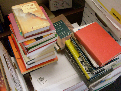 three piles of books