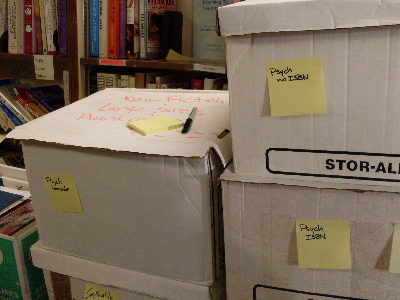 stacked labelled book boxes