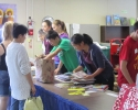 Teen volunteers working as cashiers in the Children\'s Room